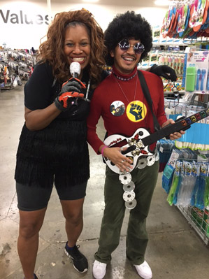 Eco Thrift staff members rock out as Guitar Heroes for Halloween
