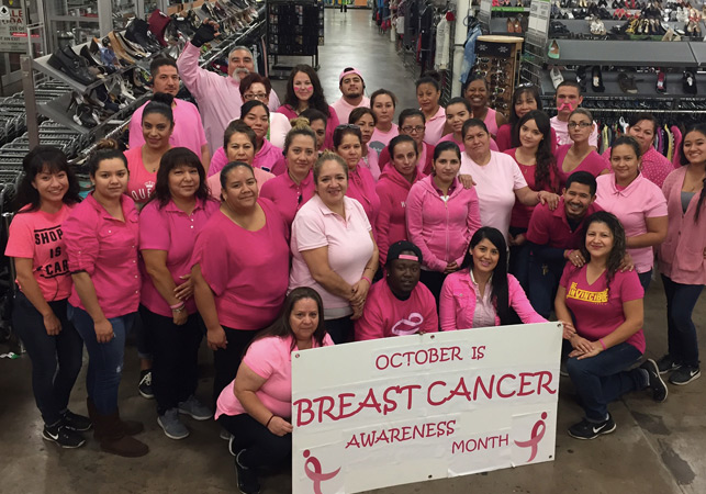 EcoThrift employees pose for a group picture on breast cancer awareness day