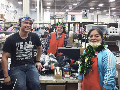 Happy EcoThrift workers pose with their holiday flair